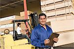 Warehouseman and forklift truck driver Stock Photo - Premium Royalty-Free, Artist: AlaskaStock              , Code: 693-03707101