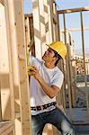 Construction worker on scaffoldings Stock Photo - Premium Royalty-Free, Artist: Minden Pictures, Code: 693-03707230