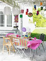 Table and decorated patio after birthday party Stock Photo - Premium Royalty-Freenull, Code: 693-03707923