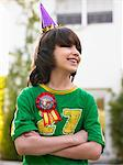 Portrait of boy (10-12) in party hat laughing, arms crossed Stock Photo - Premium Royalty-Free, Artist: Photocuisine, Code: 693-03707926