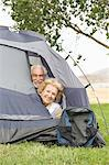 Senior couple with heads at tent flap Stock Photo - Premium Royalty-Free, Artist: F1Online, Code: 693-03707958
