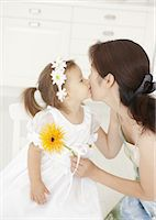 Girl kissing her mother Stock Photo - Premium Royalty-Freenull, Code: 670-03709912