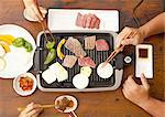 Parents and children eating korean barbecue Stock Photo - Premium Royalty-Free, Artist: Photocuisine, Code: 670-03710218