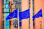Belgium, Wallonia, Brussels; Three flags carrying the European Union emblem in front of the E.U headquarters Stock Photo - Premium Rights-Managed, Artist: AWL Images, Code: 862-03710367