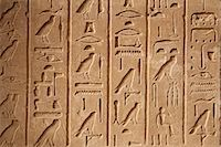 egyptian hieroglyphics - Egypt, Karnak. Hieroglyphics on one of many decorated blocks at Karnak. Stock Photo - Premium Rights-Managednull, Code: 862-03710907