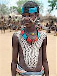A smart young Hamar youth at Turmi Market.The Hamar are semi-nomadic pastoralists who live in harsh country around the Hamar Mountains of Southwest Ethiopia. Their whole way of life is based on the needs of their livestock. Cattle are economically and culturally their most important asset. Stock Photo - Premium Rights-Managed, Artist: AWL Images, Code: 862-03711117