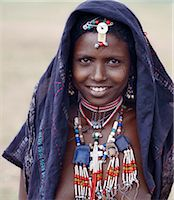 An Afar girl has tribal scarification on her cheeks. Scarification is practiced in only a few sections of her tribe. Proud and fiercely independent,the nomadic Afar people live in the low-lying dese