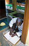 Ghana,Northern region,Tamale. A Muslim prays and reads the Quran at a Mosque in Tamale during Ramadan. Stock Photo - Premium Rights-Managed, Artist: AWL Images, Code: 862-03711639