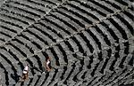 The theatre at Epiduarus is the best preserved in Greece. Ideally you should visit this extraordinary site early in the day with just one other person who can demonstrate the theatre's near-flawless acoustics by dropping a coin on the stage while you sit 54 rows up the tiered seats. Stock Photo - Premium Rights-Managed, Artist: AWL Images, Code: 862-03711687