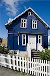 Iceland,Reykjavik. A traditional wood framed house with gingerbread facias sits easily within the architecture of the main residential area. Stock Photo - Premium Rights-Managed, Artist: AWL Images, Code: 862-03711783