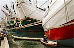 Indonesia,Jakarta. Bugis Trade Boats being repaired and loaded in the port of Sunda Kelapa. Sunda Kelapa,better known as Pasar Ikan (meaning fish market) is located at the mouth of the Ciliwung river. It was formerly the harbor town of Sunda Kelapa where the Portuguese traded with the Hindu Kingdom of Pajajaran in the early 16th century. Stock Photo - Premium Rights-Managed, Artist: AWL Images, Code: 862-03711834