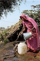 India,Rajasthan,Rohet. Without running water in their homes,the village well and water pump become a meeting point for the women of the communities. Stock Photo - Premium Rights-Managednull, Code: 862-03711995