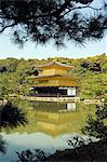 Golden Pavilion temple framed by tree branches over pond Stock Photo - Premium Rights-Managed, Artist: AWL Images, Code: 862-03712485