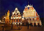 Couple standing outside House of Blackheads in Town Hall Square (Ratslaukums), Riga, Latvia Stock Photo - Premium Rights-Managed, Artist: AWL Images, Code: 862-03712662