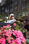 Woman drinking coffee at outdoor cafe, Riga, Latvi. Stock Photo - Premium Rights-Managed, Artist: AWL Images, Code: 862-03712713
