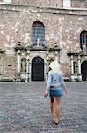 Woman walking towards St Peter's, Riga, Latvi. Stock Photo - Premium Rights-Managed, Artist: AWL Images, Code: 862-03712716