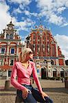Woman sitting outside House of Blackheads in Town Hall Square (Ratslaukums), Riga, Latvi. Stock Photo - Premium Rights-Managed, Artist: AWL Images, Code: 862-03712719