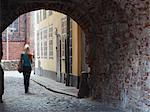 Woman walking through archway in Jana Seta, Riga, Latvi. Stock Photo - Premium Rights-Managed, Artist: AWL Images, Code: 862-03712722