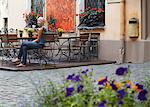 Woman sitting at cafe in Jana Seta, Riga, Latvi. Stock Photo - Premium Rights-Managed, Artist: AWL Images, Code: 862-03712723