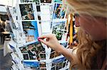 Lithuania, Vilnius, Woman Looking At Postcards At Craft Market On Pilies Gatv. Stock Photo - Premium Rights-Managed, Artist: AWL Images, Code: 862-03712837