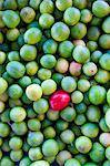 Mexico. A red fruit in a pile of limes Stock Photo - Premium Rights-Managed, Artist: AWL Images, Code: 862-03712893