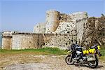 Syria. Motorbike in front of the crusader castle of Krak des Chevaliers. Stock Photo - Premium Rights-Managed, Artist: AWL Images, Code: 862-03713713
