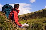 Wales, Clwyd.  A trekker stops to read his map as he approaches Moel Famau in the Clywydian Hills. Stock Photo - Premium Rights-Managed, Artist: AWL Images, Code: 862-03714213