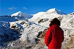 Wales, Gwynedd, Snowdonia. A walker looks westwards to the snow covered slopes of Snowdon. Stock Photo - Premium Rights-Managed, Artist: AWL Images, Code: 862-03714234