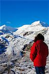 Wales, Gwynedd, Snowdonia. A walker looks westwards to the snow covered slopes of Snowdon. Stock Photo - Premium Rights-Managed, Artist: AWL Images, Code: 862-03714235