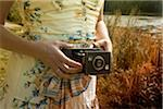 Woman Holding Folding Camera, High Park, Toronto, Ontario, Canada Stock Photo - Premium Royalty-Free, Artist: Natasha Nicholson, Code: 600-03715414