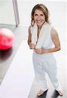 Woman in health club with towel around her neck Stock Photo - Premium Royalty-Freenull, Code: 635-03716079