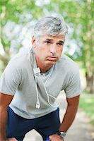 Serious man fatigued after exercise Stock Photo - Premium Royalty-Freenull, Code: 635-03716093