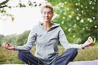 Tranquil woman practicing yoga Stock Photo - Premium Royalty-Freenull, Code: 635-03716103