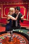 Girlfriend kissing winning boyfriend at roulette table Stock Photo - Premium Royalty-Free, Artist: Ursula Klawitter, Code: 635-03716324