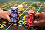 People placing bets with gambling chips Stock Photo - Premium Royalty-Free, Artist: Siephoto, Code: 635-03716344
