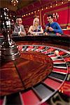 People watching ball spinning on roulette wheel Stock Photo - Premium Royalty-Free, Artist: Ty Milford, Code: 635-03716348