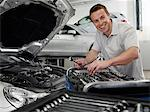 Mechanic working on car engine Stock Photo - Premium Royalty-Free, Artist: Blend Images, Code: 635-03716387