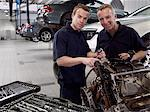 Mechanics working on engine in auto repair shop Stock Photo - Premium Royalty-Free, Artist: Ron Fehling, Code: 635-03716441