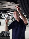 Mechanic working underneath car Stock Photo - Premium Royalty-Freenull, Code: 635-03716460