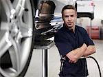 Mechanic standing with car in auto repair shop Stock Photo - Premium Royalty-Free, Artist: Blend Images             , Code: 635-03716469