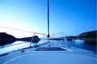 sports and sailing - Bow of boat sailing on lake Stock Photo - Premium Royalty-Freenull, Code: 635-03716589