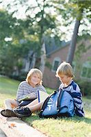 Brothers Sitting on Grass with Homework Stock Photo - Premium Rights-Managednull, Code: 700-03719317