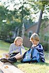 Brothers Sitting on Grass with Homework Stock Photo - Premium Rights-Managed, Artist: Kevin Dodge, Code: 700-03719317