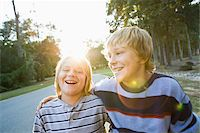 Brothers Outdoors with Arms Around Each Other Stock Photo - Premium Rights-Managednull, Code: 700-03719320