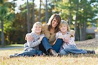 Mother Sitting with Sons on Grass Stock Photo - Premium Rights-Managednull, Code: 700-03719330
