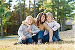 Mother Sitting with Sons on Grass Stock Photo - Premium Rights-Managed, Artist: Kevin Dodge, Code: 700-03719331