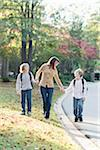Mother Walking Sons to School