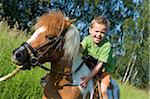 Boy Riding Shetland Pony Stock Photo - Premium Rights-Managed, Artist: Bettina Salomon, Code: 700-03720145