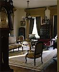 Waverley, Columbus, Mississippi, 1852. The small sitting room with grandfather clock. Architects: Charles I. Pond Stock Photo - Premium Rights-Managed, Artist: Arcaid, Code: 845-03721458