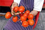 Chef Holding Tomatoes Stock Photo - Premium Rights-Managed, Artist: foodanddrinkphotos, Code: 824-03722685